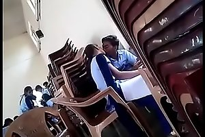 girl and boy kissing in school
