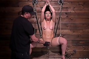 Hogtied with exposed ass babe gets whipped