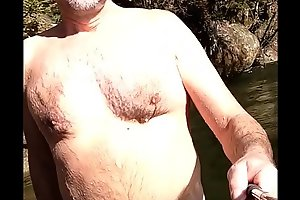 bear with uncut soft penis skinny-dipping