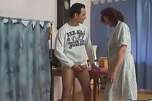 Guy bangs sewing old granny