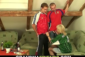 Very old blonde woman pleases two buddy