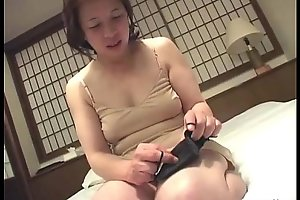 Asian granny inserts a sex tool in her bawdy cleft