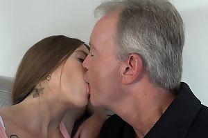 Sex-starved brunette pleasuring old man on the sofa