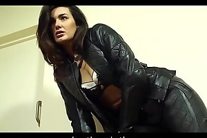 Brunette posing in leather jacket, leather pants and high leather boots